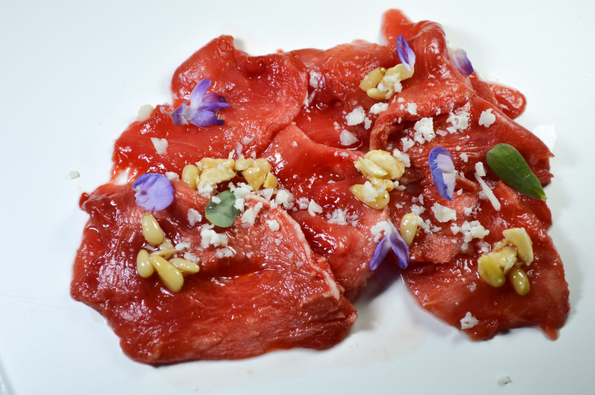 Dehydrated and roasted watermelon carpaccio.